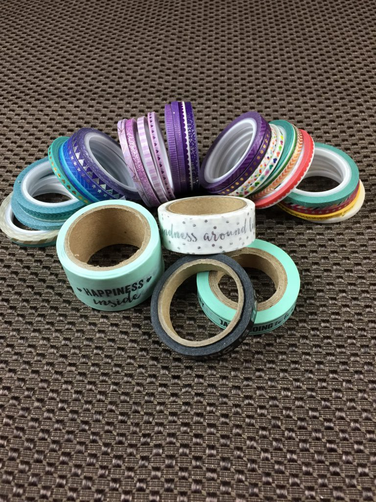 Washi tape in multiple widths and colors.